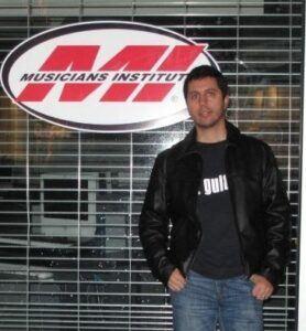 Vin in front of MI school logo